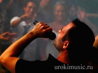 Closeup of a singer singing at nightclub